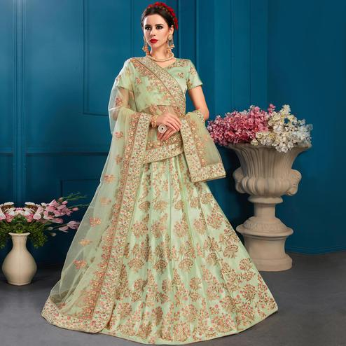 Dazzling Pista Green Colored Partywear Embroidered Satin Lehenga Choli