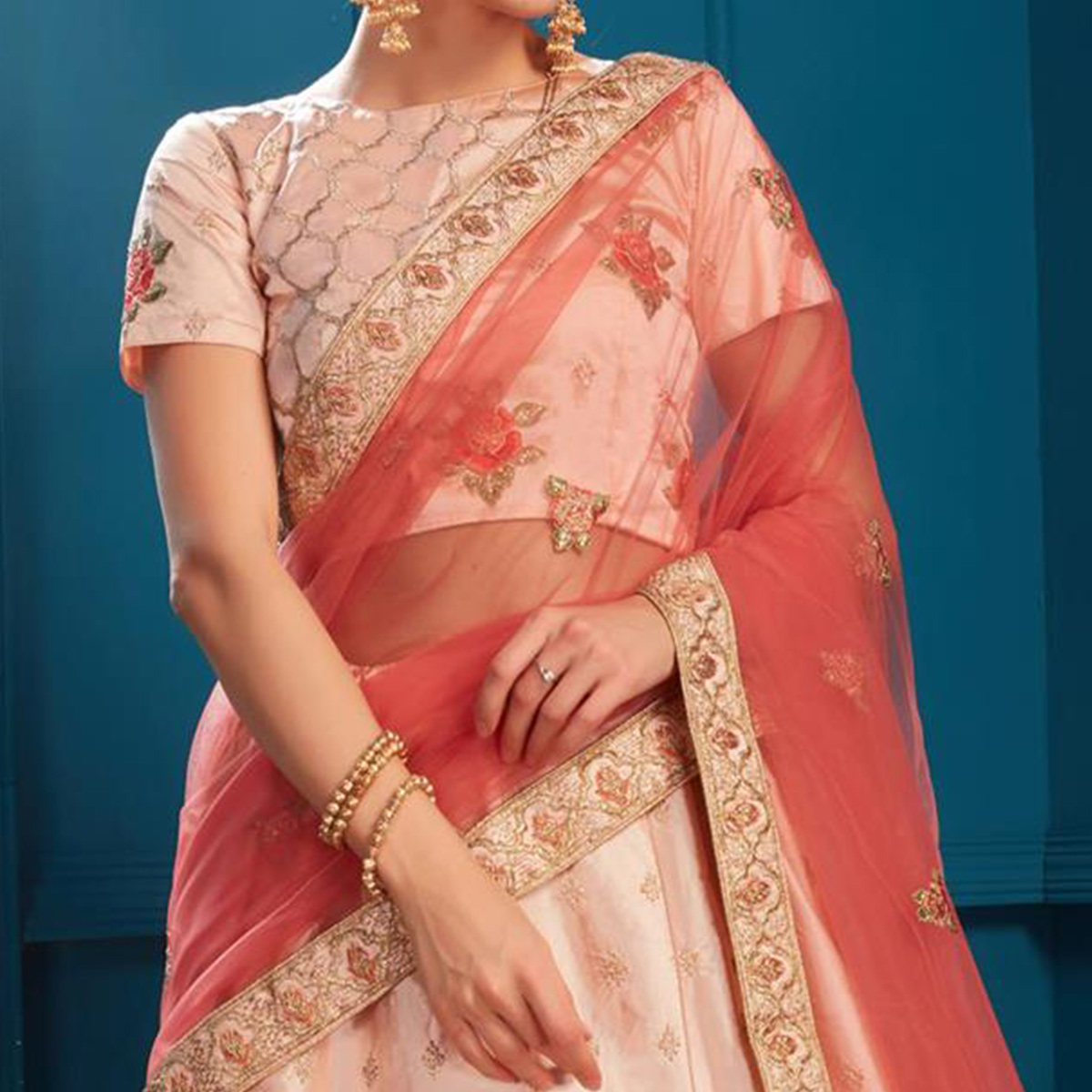 Flattering Light Peach Colored Partywear Embroidered Satin Lehenga Choli