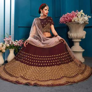 Impressive Dark Brown Colored Partywear Embroidered Satin Lehenga Choli