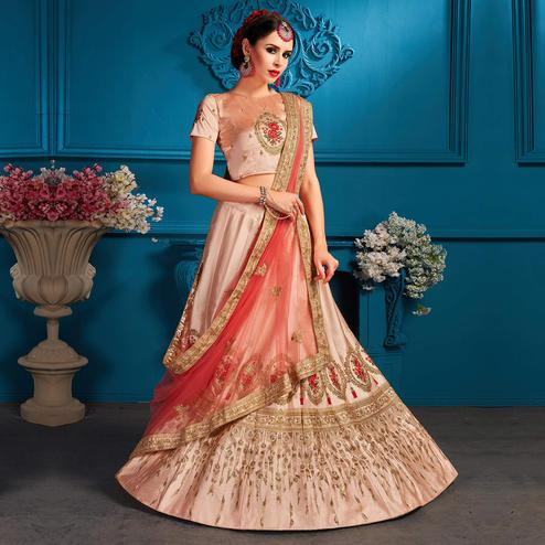 Excellent Light Peach Colored Partywear Embroidered Satin Lehenga Choli