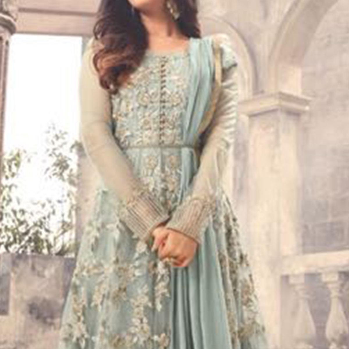 Stunning Pastel Blue Colored Party Wear Embroidered Net Anarkali Suit