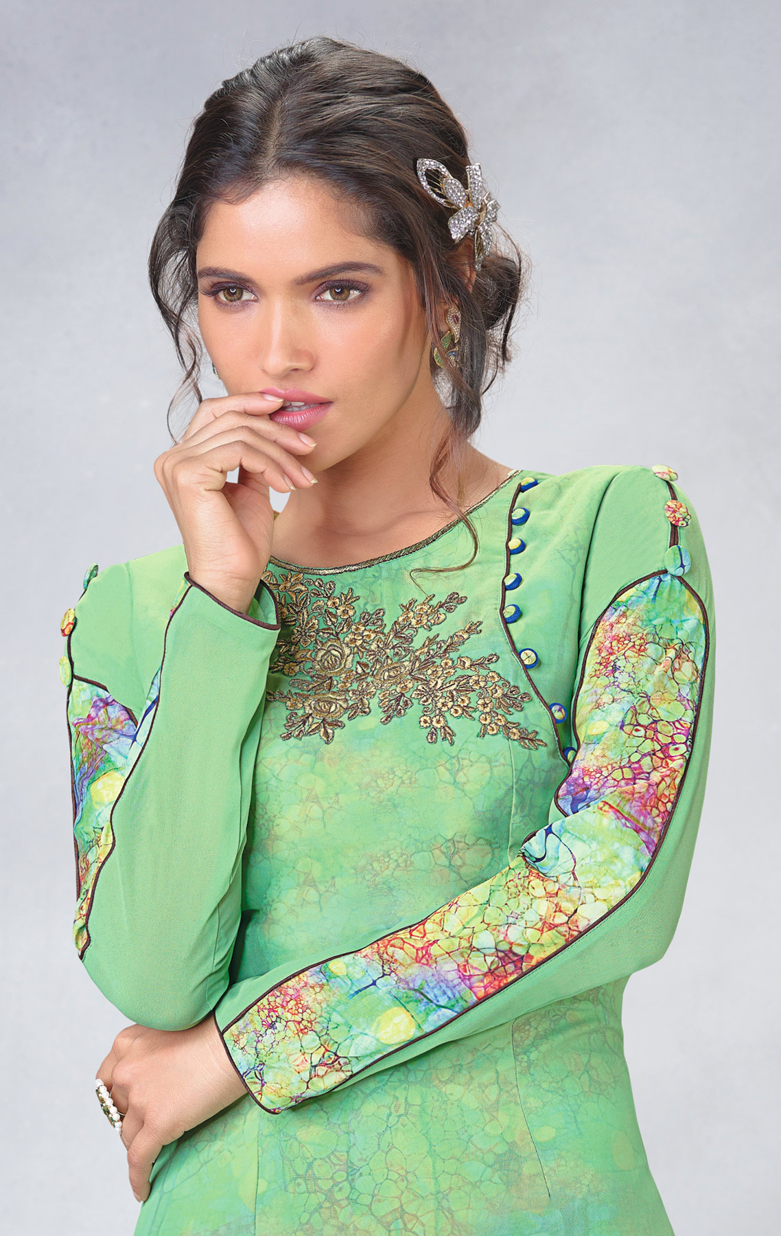 Graceful Green Designer Embroidered Faux Georgette Kurti