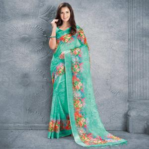 Entrancing Turquoise Colored Casual Printed Pure Linen Saree