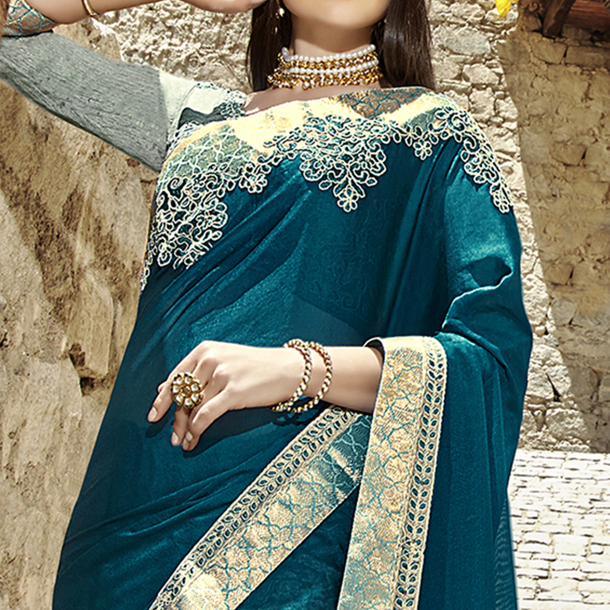 Pretty Teal Blue Colored Party Wear Embroidered Georgette Saree