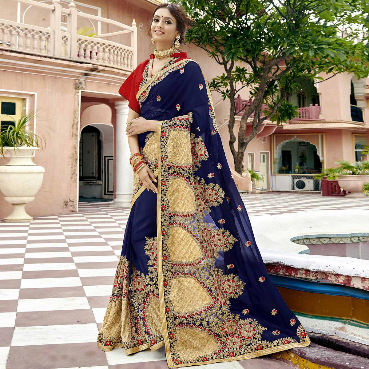 Impressive Navy Blue Colored Party Wear Embroidered Georgette Saree