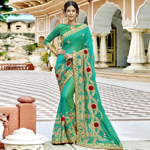 Flaunt Turquoise Green Colored Party Wear Embroidered Georgette Saree
