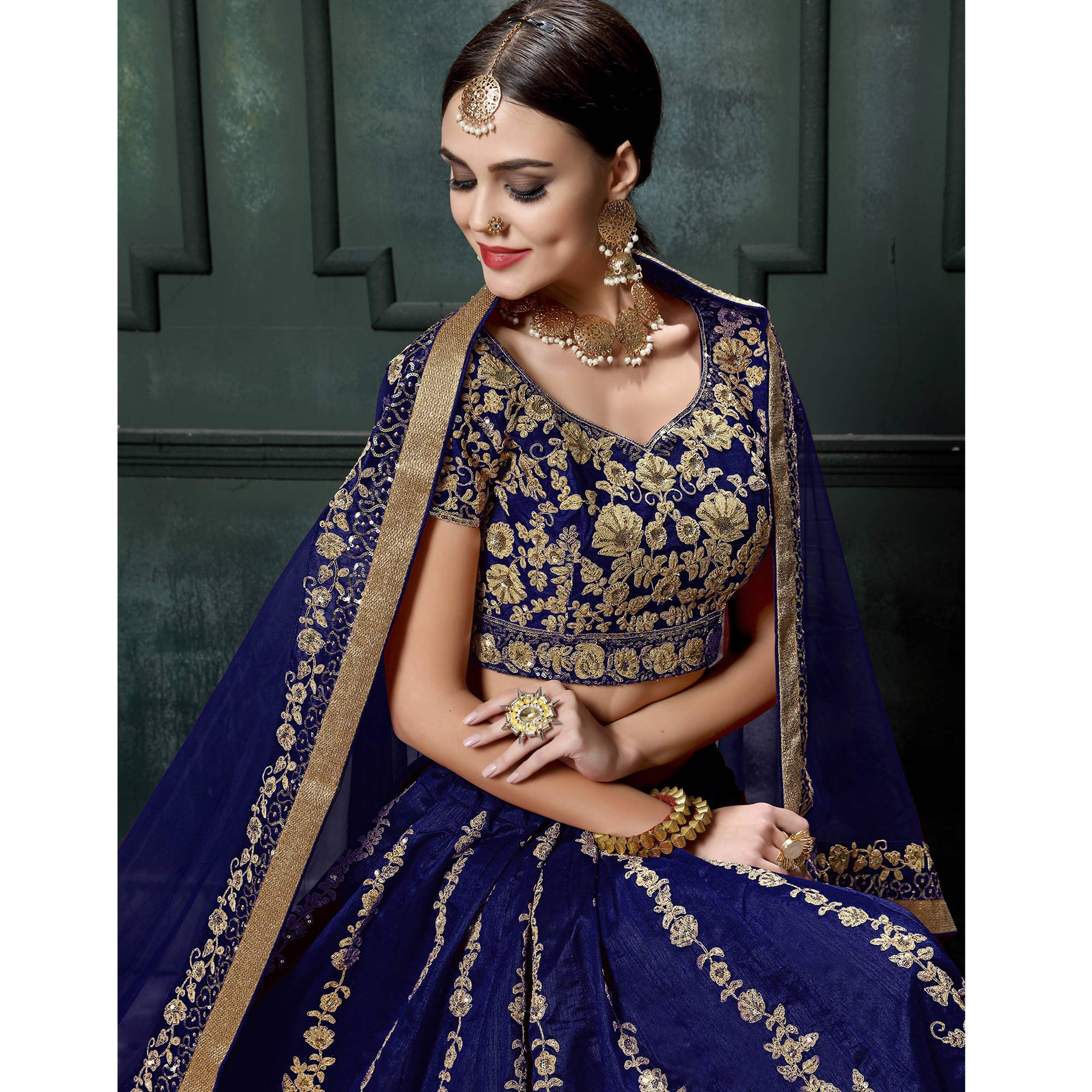 Prominent Blue Colored Wedding Wear Embroidered Raw Silk Lehenga