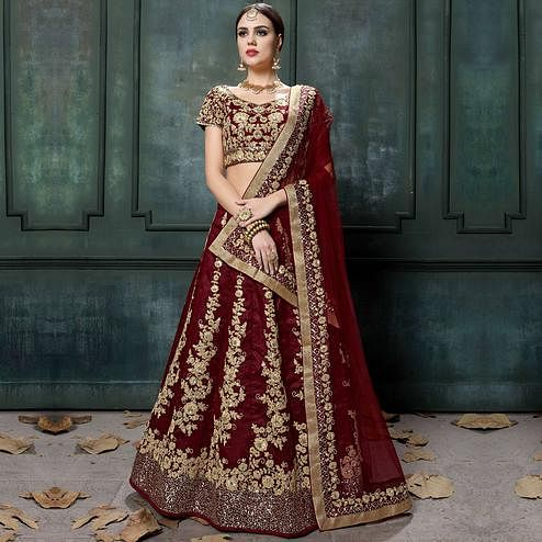 Innovative Maroon Colored Wedding Wear Embroidered Raw Silk Lehenga