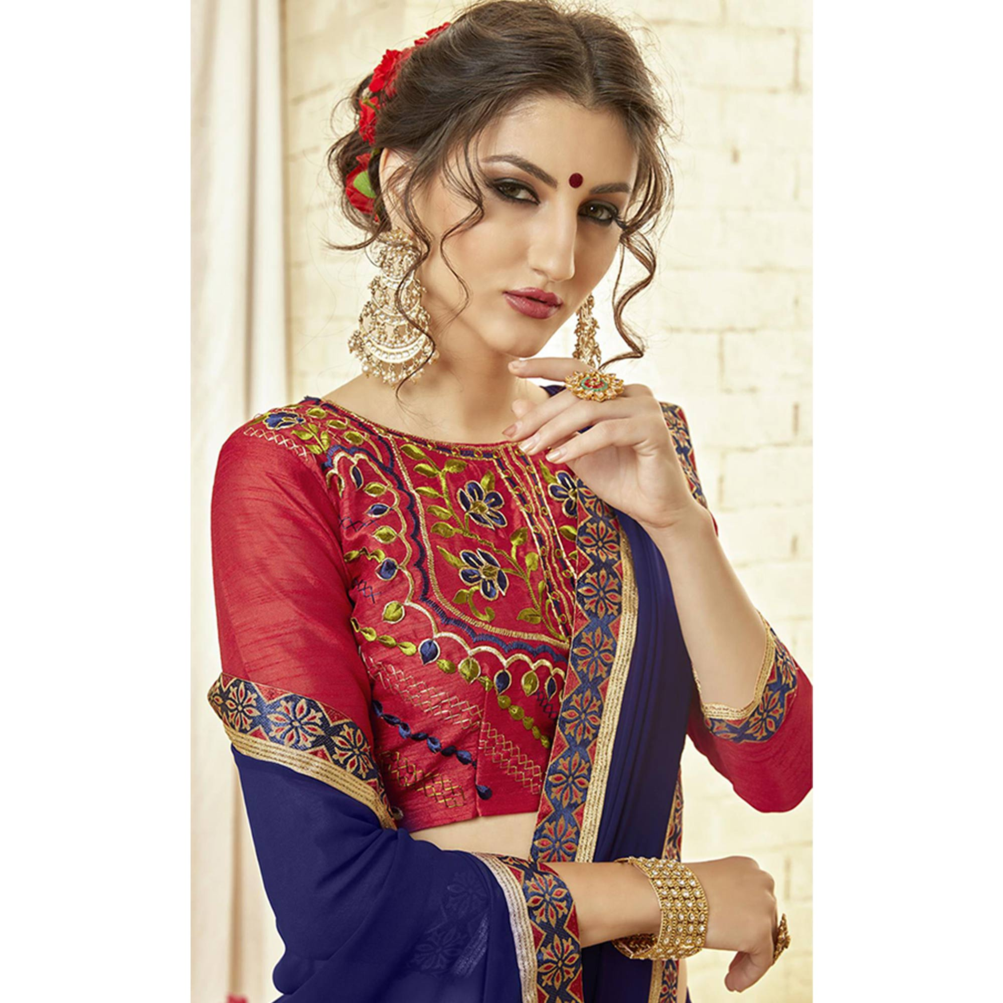 Amazing Royal Blue Colored Partywear Embroidered Georgette Saree