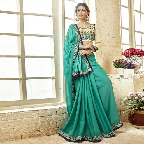 Glowing Turquoise Green Colored Partywear Embroidered Georgette Saree