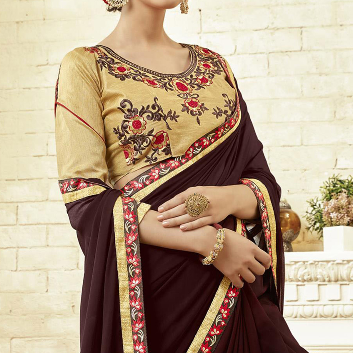 Stunning Brown Colored Partywear Embroidered Georgette Saree