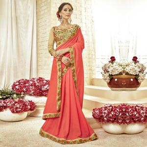 Adorable Dark Peach Colored Partywear Embroidered Georgette Saree