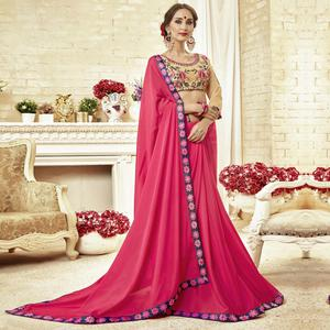 Magnetic Dark Pink Colored Partywear Embroidered Georgette Saree