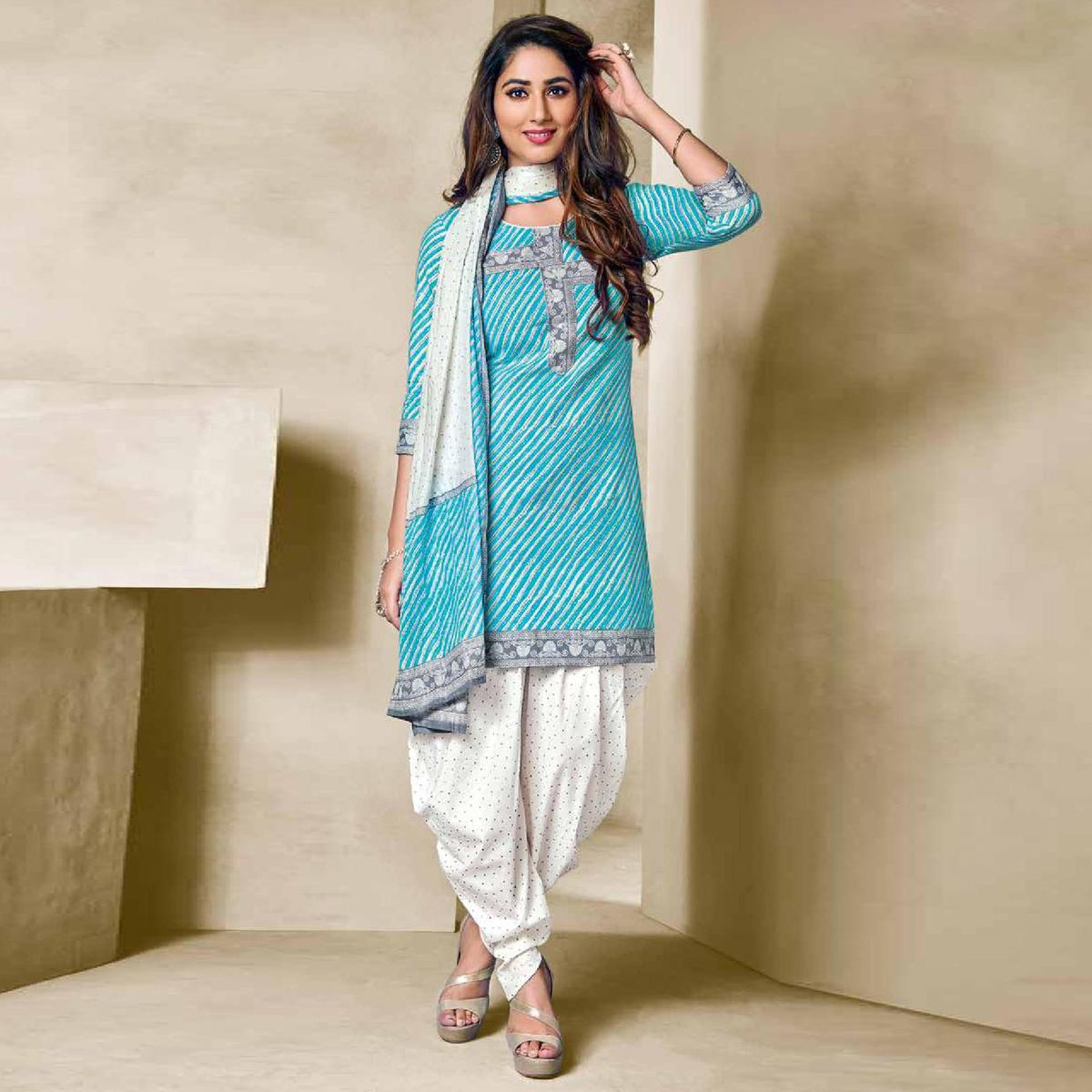 Stunning Sky Blue Colored Casual Wear Printed Cotton Dress Material