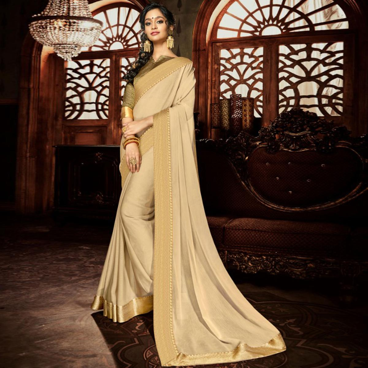 Opulent Cream Colored Party Wear Woven Georgette Saree
