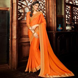 Energetic Orange Colored Party Wear Woven Georgette Saree