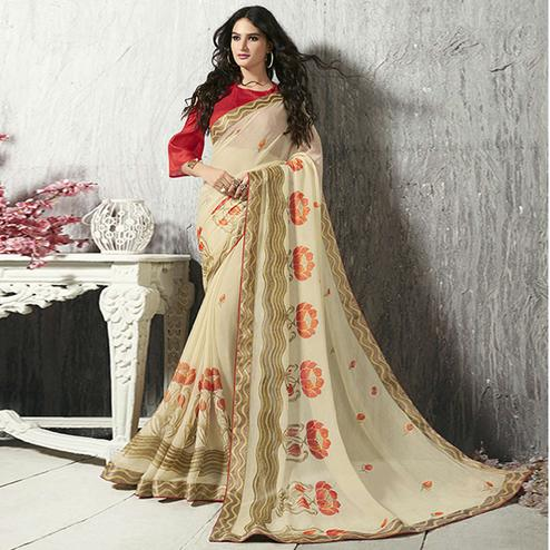 Flamboyant Cream Colored Party Wear Printed Chiffon-Brasso Saree