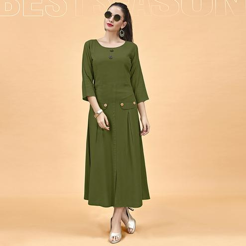 Capricious Olive Green Colored Party Wear Fancy Heavy Rayon Kurti