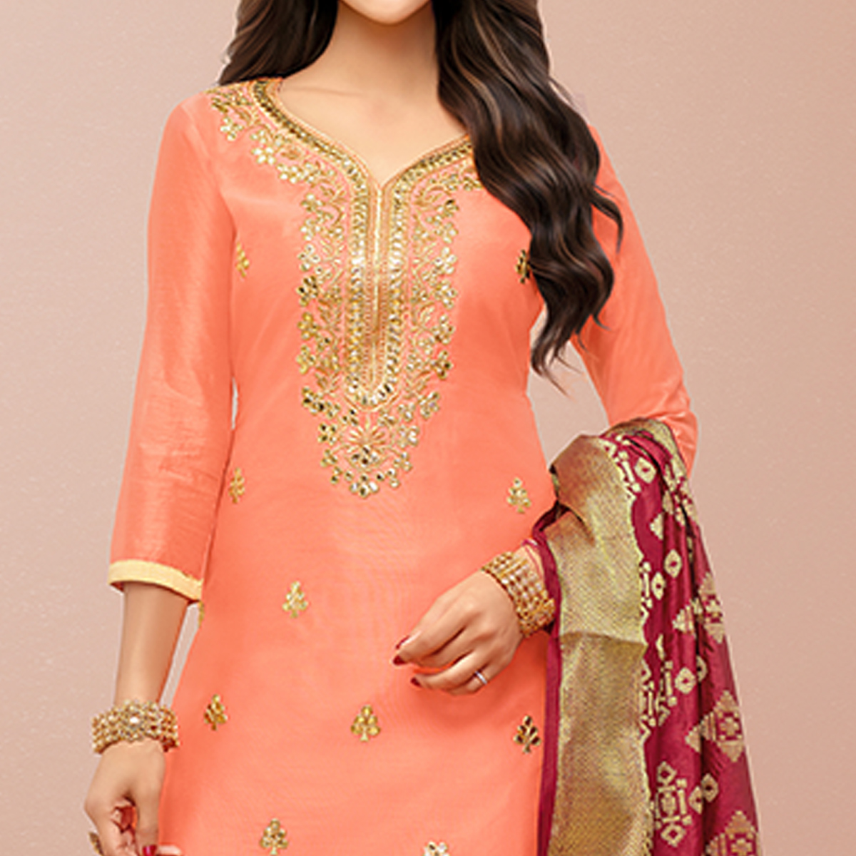 Unique Peach Colored Party Wear Embroidered Silk Patiala Suit