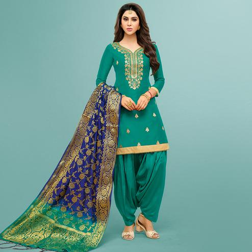 Radiant Teal Green Colored Party Wear Embroidered Silk Patiala Suit