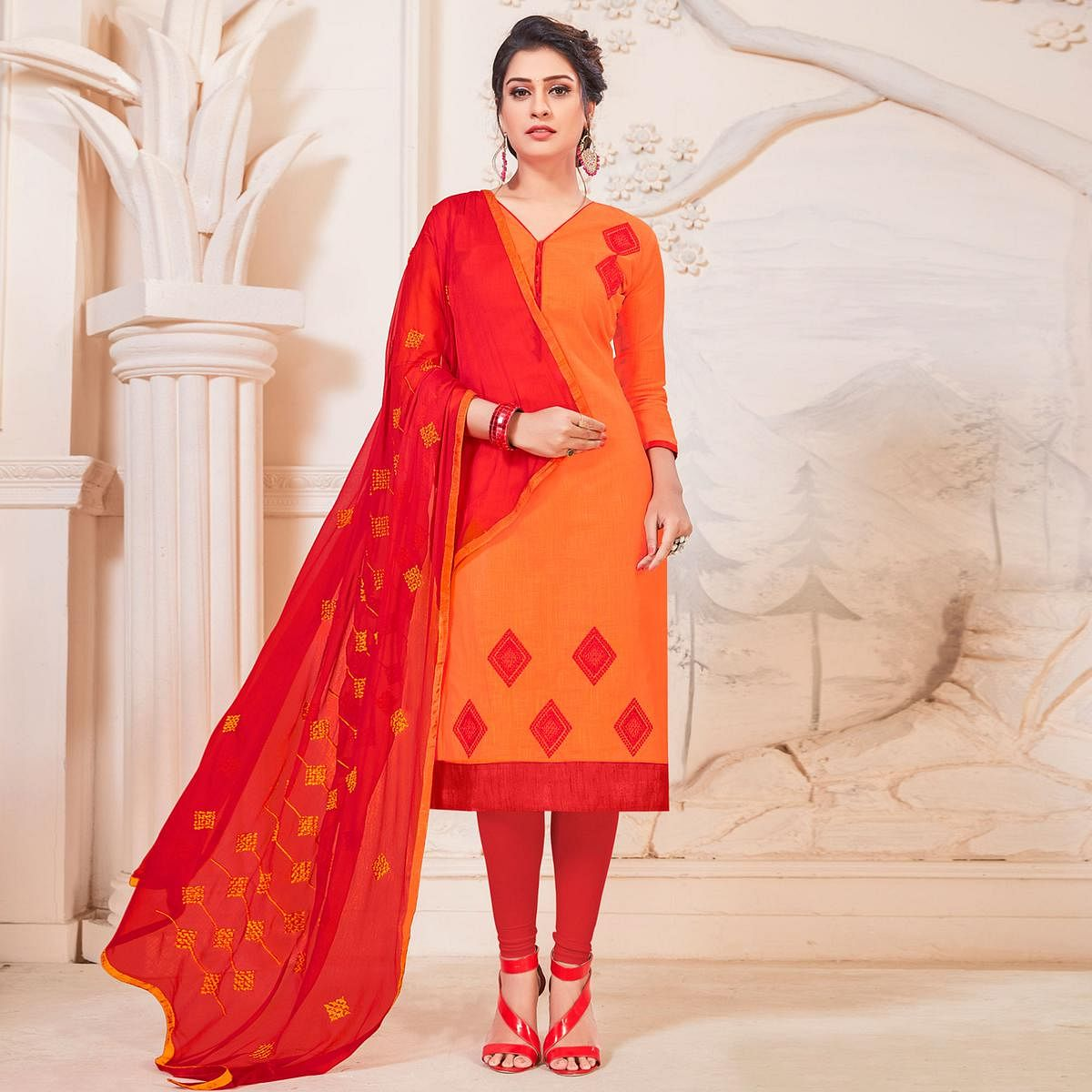 Entrancing Orange Colored Partywear Embroidered Cotton Dress Material