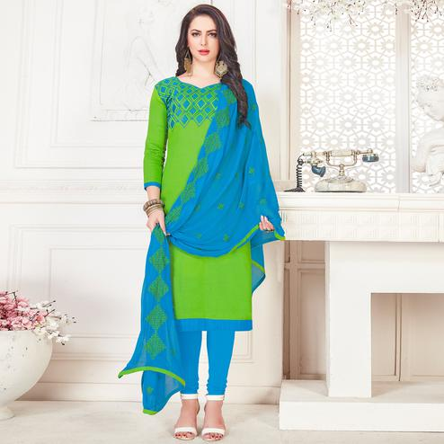Gleaming Green Colored Partywear Embroidered Cotton Dress Material