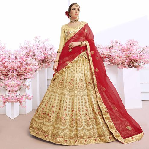 Appealing Cream Colored Partywear Embroidered Silk Lehenga Choli