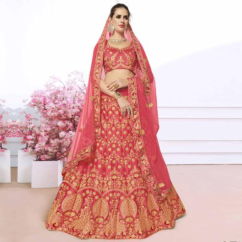 Captivating Peach Colored Partywear Embroidered Silk Lehenga Choli