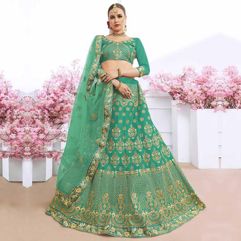 Groovy Turquoise Green Colored Partywear Embroidered Silk Lehenga Choli