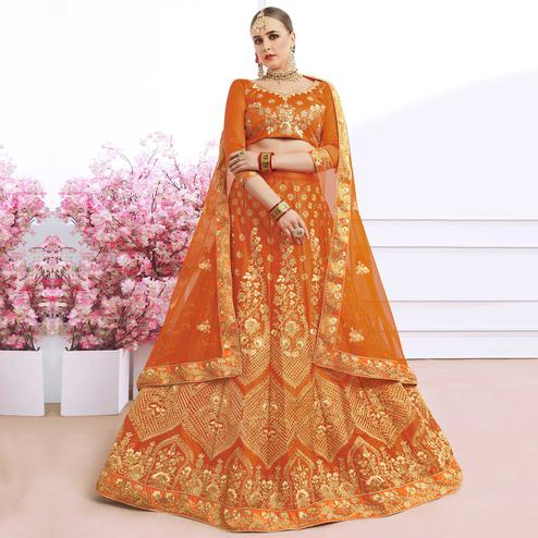 Prominent Orange Colored Partywear Embroidered Silk Lehenga Choli