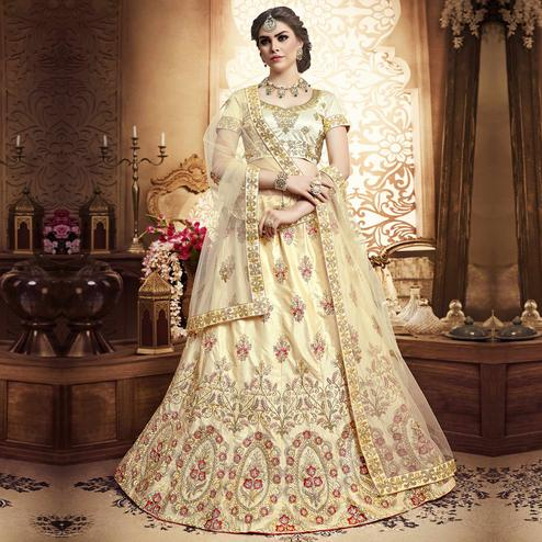Radiant Cream Colored Wedding Wear Embroidered Silk Lehenga Choli