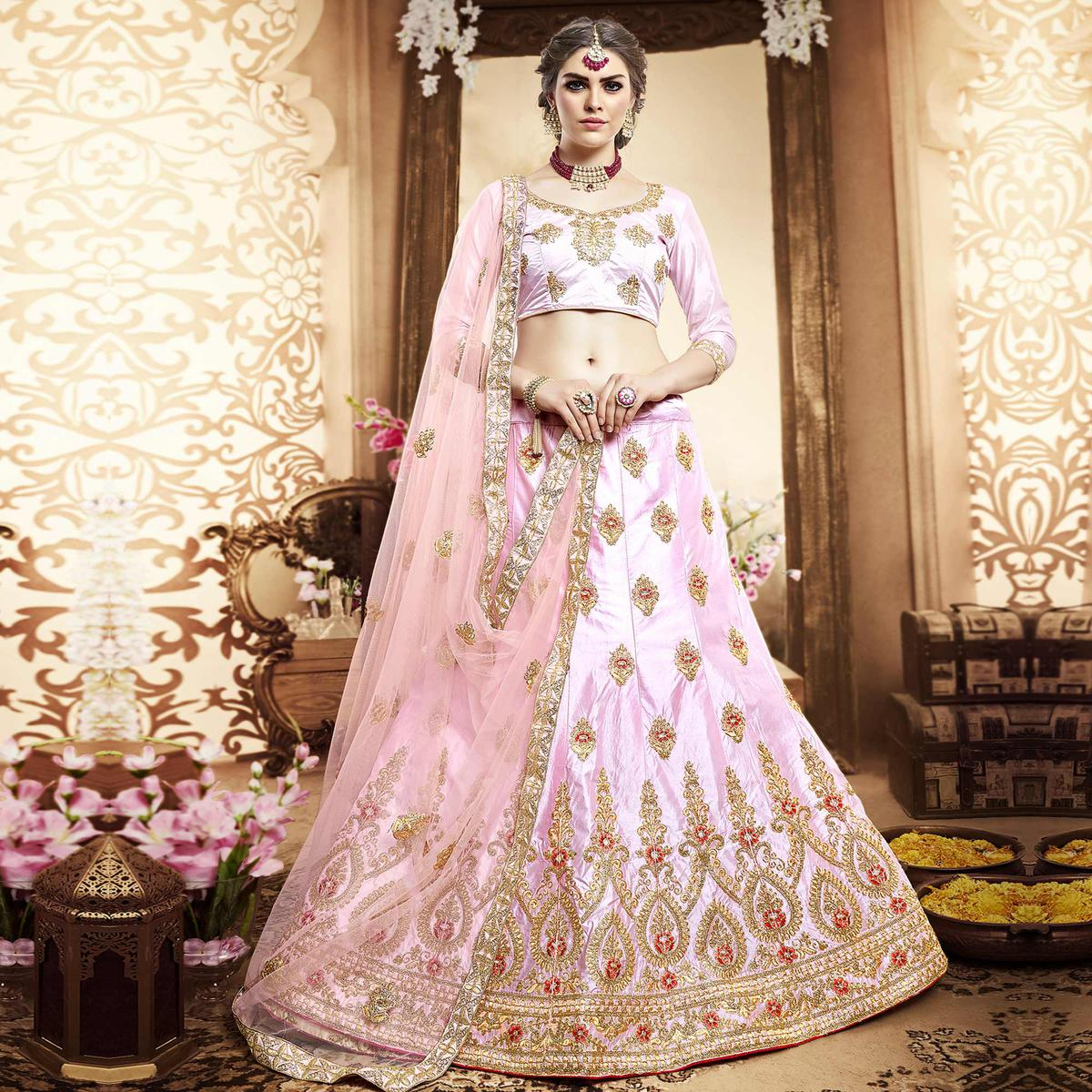 Pleasant Soft Pink Colored Wedding Wear Embroidered Silk Lehenga Choli