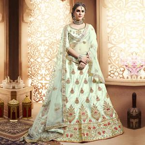 Opulent Mint Green Colored Wedding Wear Embroidered Silk Lehenga Choli
