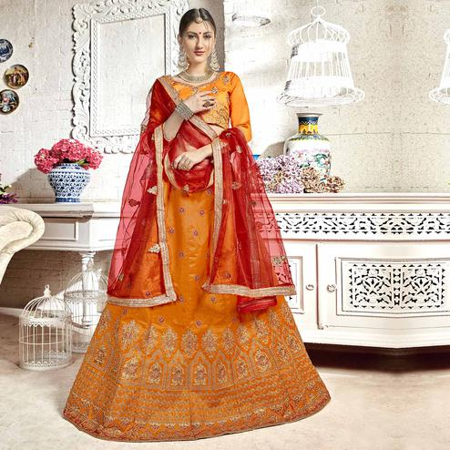 Pleasant Orange Colored Partywear Embroidered Banglori Silk Lehenga Choli