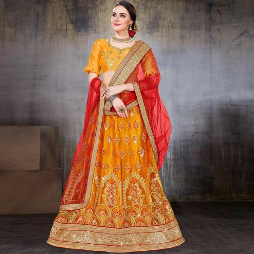 Gleaming Mustard Yellow Colored Wedding Wear Embroidered Net Lehenga Choli