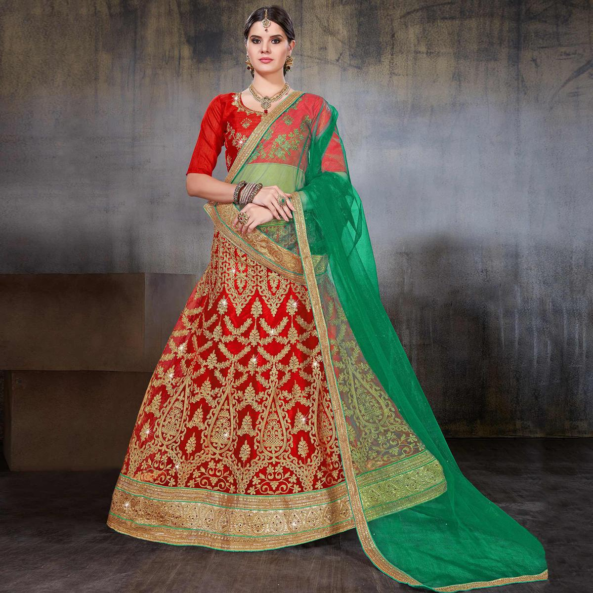 Unique Red Colored Wedding Wear Embroidered Net Lehenga Choli