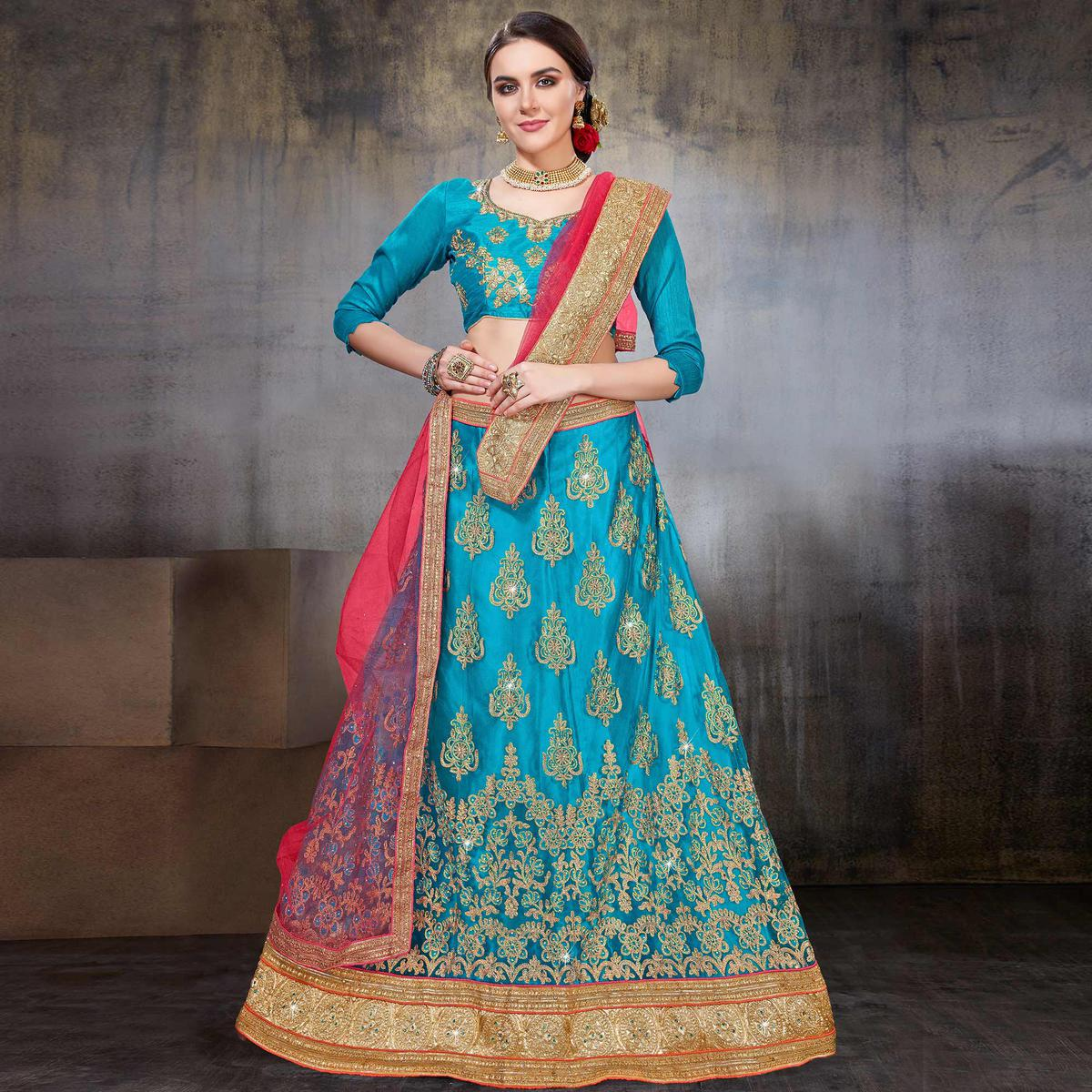 Magnetic Deep Sky Blue Colored Wedding Wear Embroidered Net Lehenga Choli