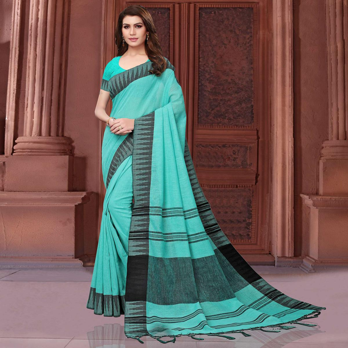 Entrancing Turquoise Green Colored Festive Wear Linen Saree