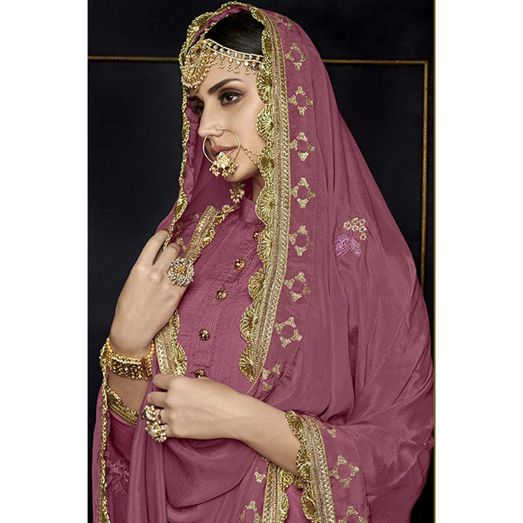 Arresting Mauve Colored Party Wear Embroidered Viscose Palazzo Suit