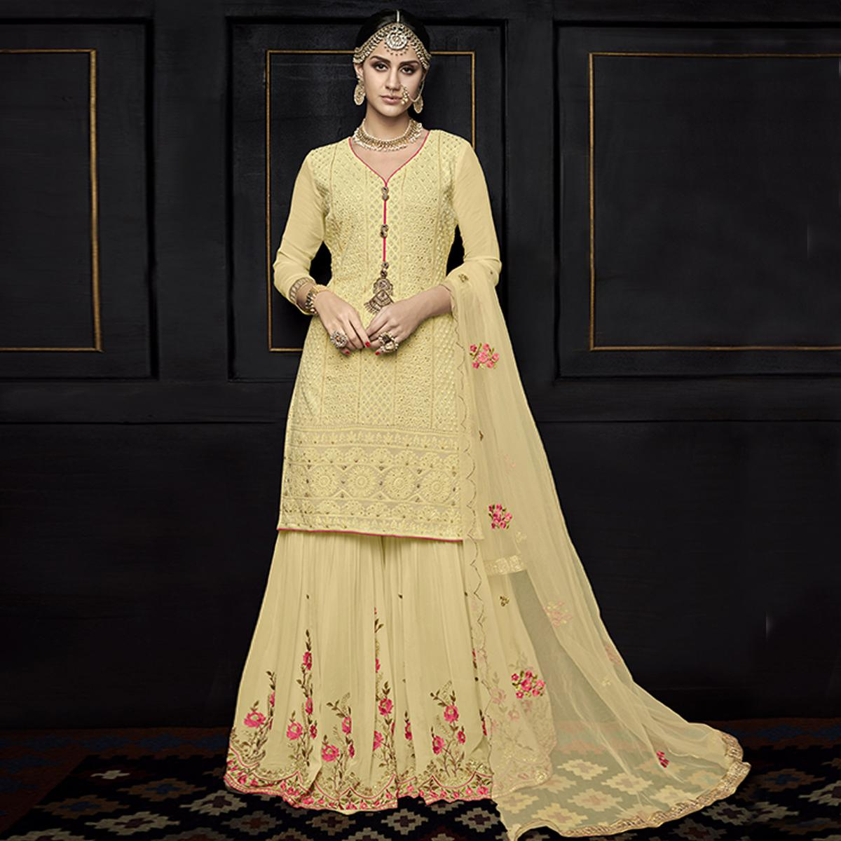 Desirable Light Yellow Colored Party Wear Embroidered Viscose Palazzo Suit