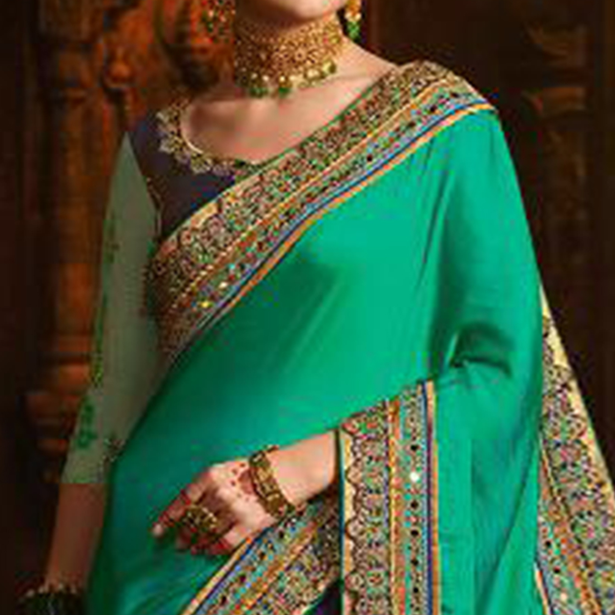 Magnetic Turquoise Green-Navy Blue Colored Wedding Wear Embroidered Silk Saree