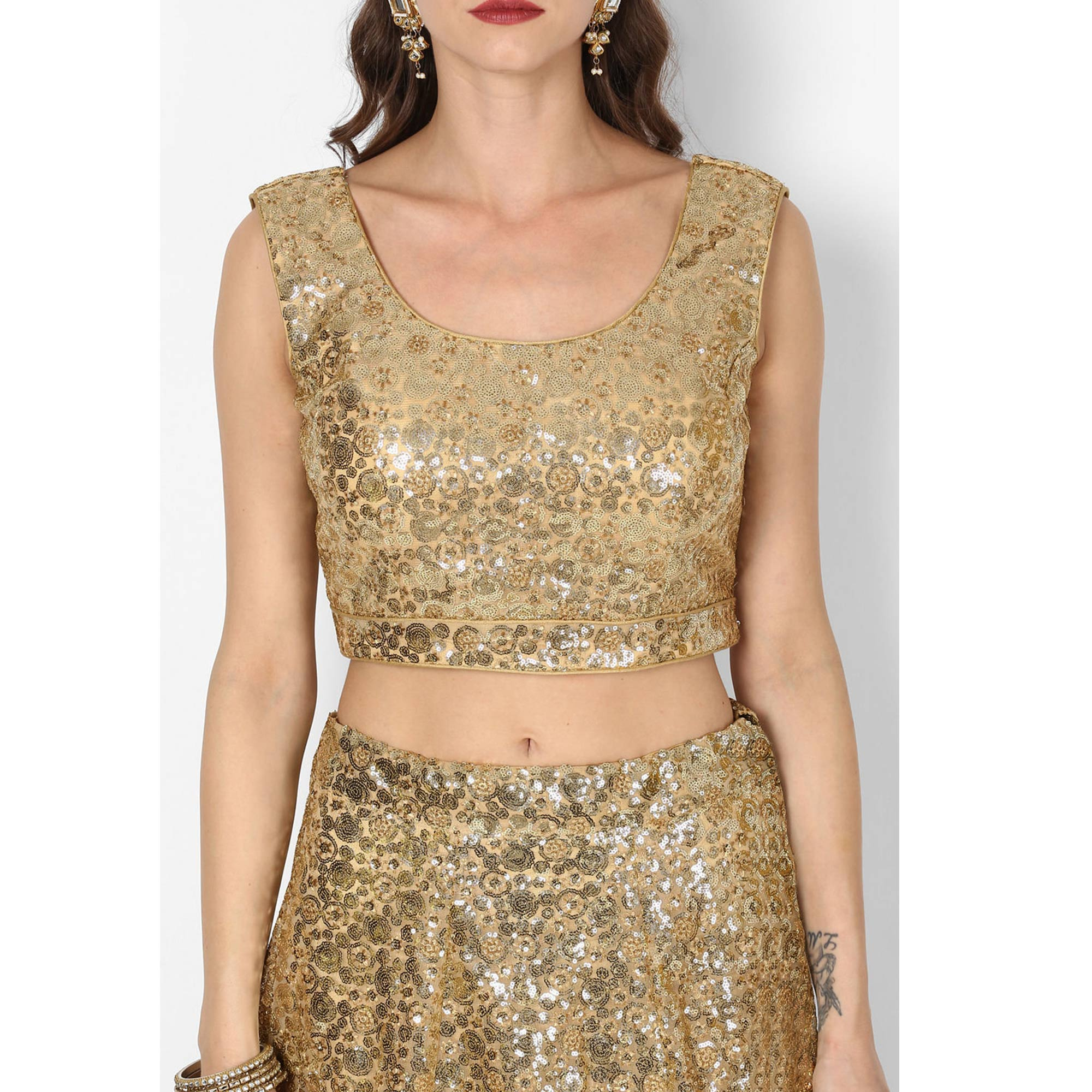 Stunning Golden Colored Partywear Embroidered Netted Lehenga Choli