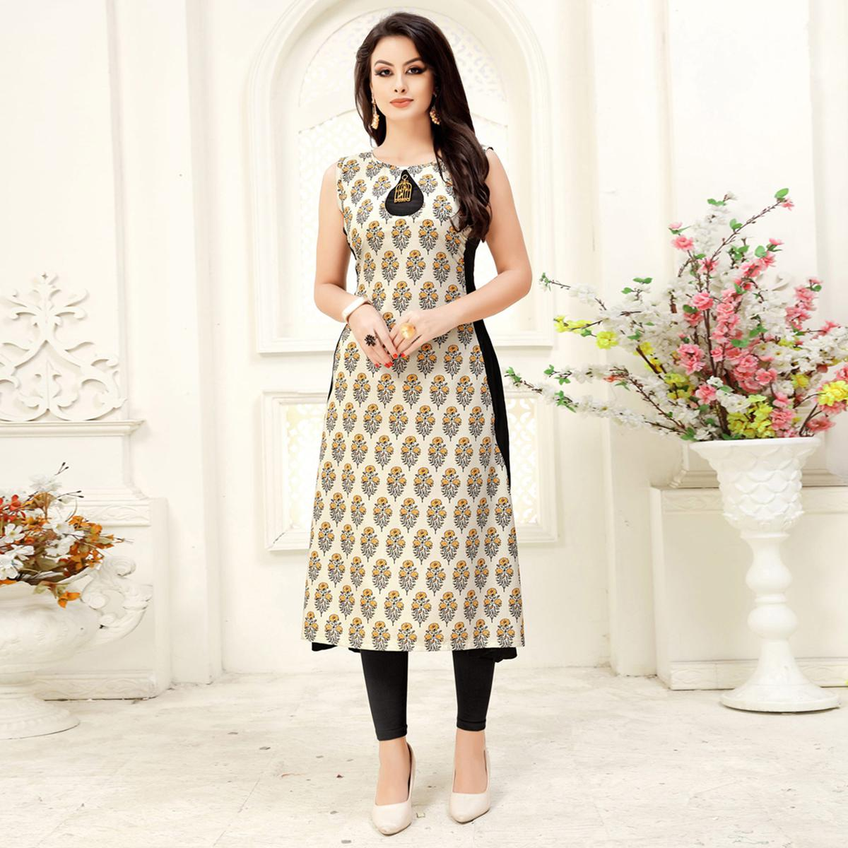 Gleaming Cream & Black Colored Party Wear Printed Crepe Kurti