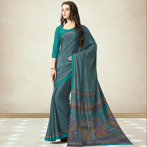 Exceptional Teal Blue Colored Casual Printed Crepe Saree