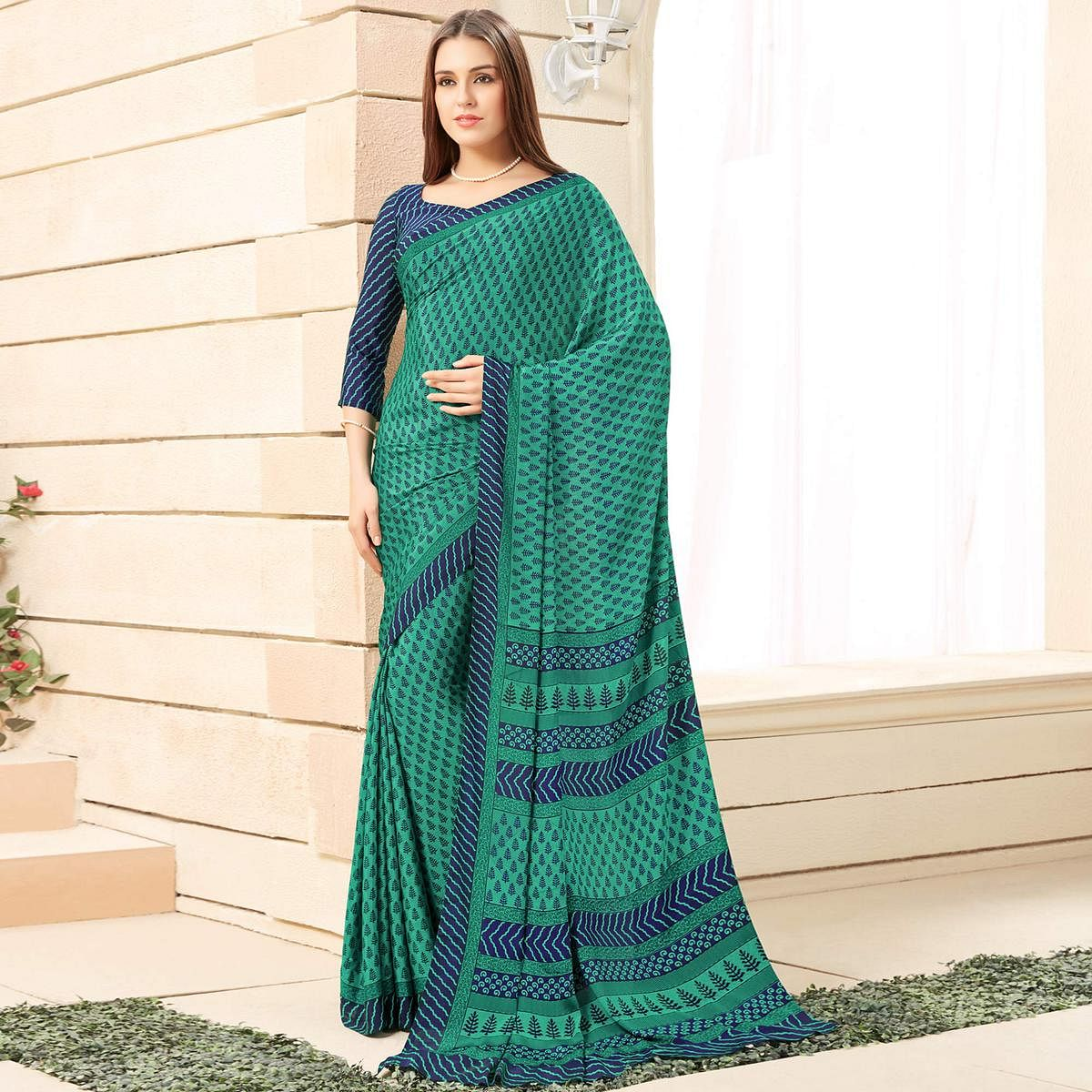 Lovely Turquoise Green Colored Casual Printed Crepe Saree
