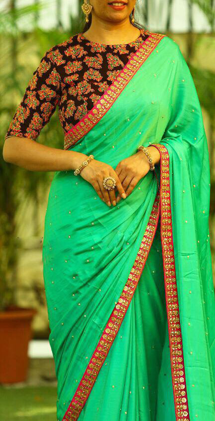 Marvellous Green Designer Partywear Georgette Saree