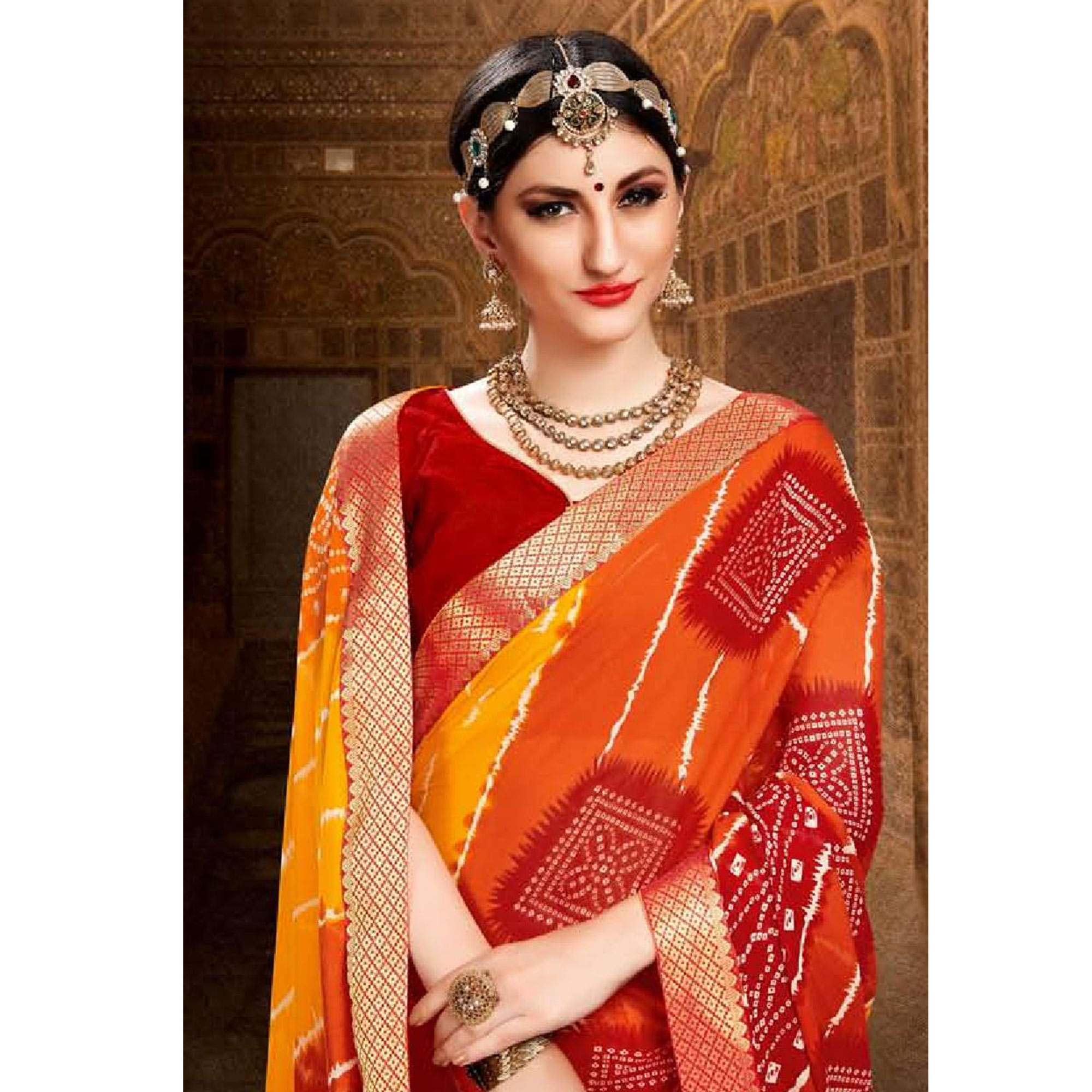 Arresting Yellow-Orange Colored Bandhani Printed Heavy Georgette Saree With Jacquard Lace Border