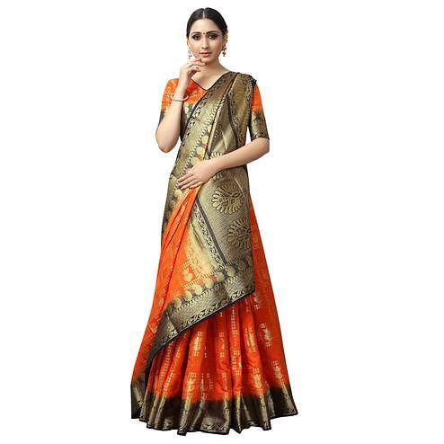 Ravishing Orange Colored Patola Style Woven Silk Saree