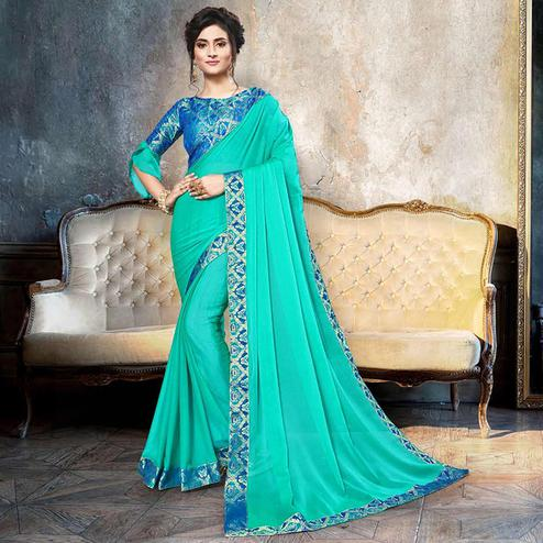 Opulent Turquoise Green Colored Partywear Printed Heavy Georgette Saree With Lace Border