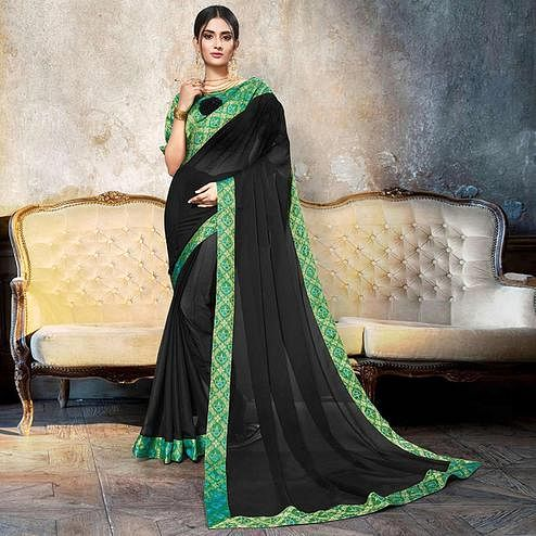 Energetic Black Colored Partywear Printed Heavy Georgette Saree With Lace Border